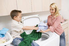 bigstock-Mother-And-Son-Doing-Laundry-5123213